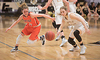 NWA Democrat-Gazette/J.T. WAMPLER  Rogers Heritage's Amber Turner and Bentonville's Krista Clark scramble for a loose ball Tuesday Jan. 26, 2015.