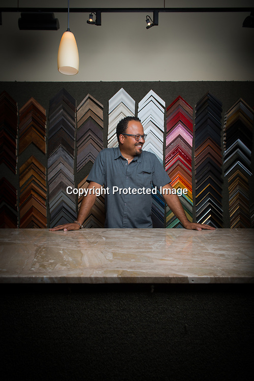 Museum Quality Framing Seattle General Manager Sean Dulan at the store in South Lake Union. Dulan helps clients find the best options for framing, at a wide range of price points to suit their budget and aesthetics. Photo by Daniel Berman