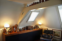 A collection of mainly Dutch Art Deco animal sculptures decorates this corner of an attic bedroom