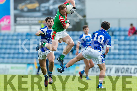 Cormac Coffey Kerins O'Rahillys in action against Chris O'Leary Kilcummin Senior Football Championship Relegation Playoff in Austin Stack Park on Sunday