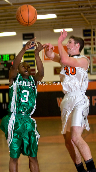 WATERTOWN, CT - 08 JANUARY 2009 -010809JT08-<br /> Wilby's Zacquan Nelson and Watertown's Kevin Froese scramble for a loose ball during Thursday's game at Watertown. Watertown won 55-54 in overtime.<br /> Josalee Thrift / Republican-American