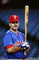 Rafael Palmeiro of the Texas Rangers during a game against the Anaheim Angels at Angel Stadium circa 1999 in Anaheim, California. (Larry Goren/Four Seam Images)