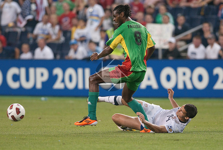 14 June 2011                         Guadeloupe midfielder Dimitri Fautrai (8) watches the ball slip away after a slide tackle by USA defender Eric Lichaj (14) in the second half.  The USA Men's National Soccer Team defeated the Guadeloupe Men's National Soccer Team 1-0 in the first qualifying round of the CONCACAF Gold Cup game at Livestrong Sporting Park in Kansas City, KS on June 14, 2011.