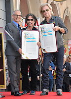 LOS ANGELES, CA. September 2, 2016: Daryl Hall &amp; John Oates with LA council member Mitch O'Farrell (left) at the Hollywood Walk of Fame star ceremony honoring musicians Daryl Hall &amp; John Oates. <br /> Picture: Paul Smith / Featureflash