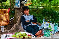 A street vendor selling produce takes a nap, near Cai Lay, Vietnam.