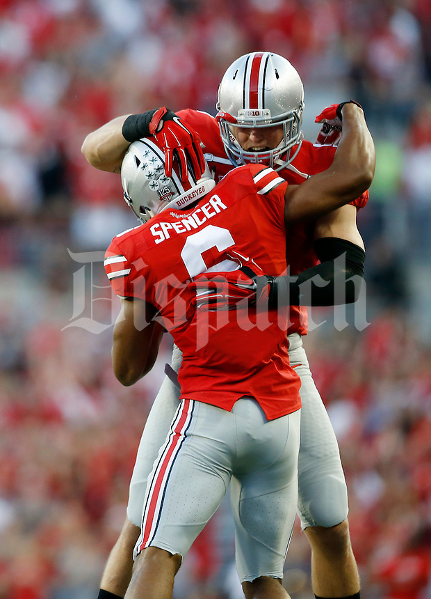 Ohio State Buckeyes tight end Jeff Heuerman (5) leaps to congratulate teammate wide receiver Evan Spencer (6) for scoring a touchdown during the second quarter of the NCAA football game at Ohio Stadium in Columbus on Sept. 27, 2014. (Adam Cairns / The Columbus Dispatch)