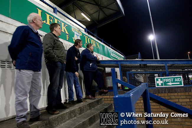 16.09.2008 Leek, England. Leek Town fans in the enclosure watching anxiously as their team tries to force an equaliser against Clitheroe in an FA Cup 1st Qualifying Round replay at Harrison Park, Leek. The first match ended in a one-all draw but it was Clitheroe who progressed to the next round winning the replay one-nil, despite having a man sent off in the second half. The preliminary stages of the FA Cup were used to determine which non-League clubs were included in the first round proper of the FA Cup. Photo by Colin McPherson.
