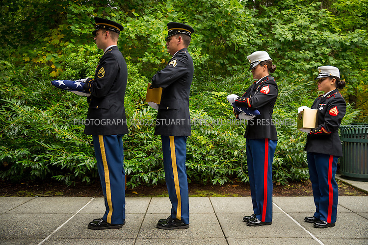 9/30/2016-- Tahoma National Cemetery, Kent, WA, USA<br /> <br /> Here:  The remains of  indigent veterans delivered by James Lindley are carried by active service members at a commitment shelter at the Tahoma National Cemetery.<br /> <br /> James Lindley, 34, an undertaker and US Marine Corp Veteran, works at the Columbia Funeral Home in Seattle, Washington and has taken it upon himself to process the remains of indigent veterans and ensure their remains are placed in Tahoma National Cemetery in nearby Kent, WASH. The veterans are given full military funerals with active service members as well as volunteers who stand-in for unavailable next-of-kin, accepting the folded flags provided by the Veterans Administration.<br /> <br /> On this day, with the help of Mr. Lindley, the remains of 4 veterans were interred at the Tahoma National Cemetery: <br /> <br /> Richard Fesler, born 1951, died 2014. US Army Veteran<br /> Rocky Stallone, born 1951, died 2014. Marine Corps veteran<br /> Russell Ristow, born 1944, died 2014. US Army veteran.<br /> Wayne Roberts, Born 1937, died 2014. US Navy veteran.<br /> <br /> <br /> Credit: Stuart Isett for The Wall Street Journal. <br /> VETBODIES<br /> <br /> &copy;2016 Stuart Isett. All rights reserved.