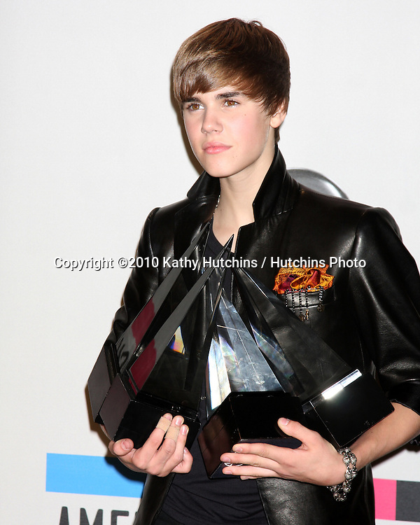 LOS ANGELES - NOV 21:  Justin Bieber in the Press Room of the 2010 American Music Awards at Nokia Theater on November 21, 2010 in Los Angeles, CA