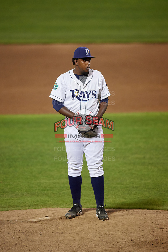 Princeton Rays relief pitcher Juan Carlos Arias (20) gets ready to deliver a pitch during the second game of a doubleheader against the Johnson City Cardinals on August 17, 2018 at Hunnicutt Field in Princeton, Virginia.  Princeton defeated Johnson City 12-1.  (Mike Janes/Four Seam Images)