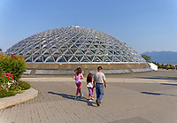 Family in front of the Bloedel Conservatory in Queen Elizabeth Park, Vancouver, BC, Canada