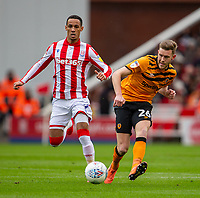 7th March 2020; Bet365 Stadium, Stoke, Staffordshire, England; English Championship Football, Stoke City versus Hull City; Callum Elder of Hull City crosses the ball as Ince of Stoke closes in
