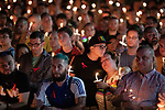 © Joel Goodman - 07973 332324 - all rights reserved . 26/08/2019. Manchester, UK. A candlelit vigil , organised by the George House Trust , in memory of the victims of HIV and AIDS , takes place in Sackville Gardens in Manchester's Gay Village , at the close of 2019's Manchester Pride . Photo credit : Joel Goodman