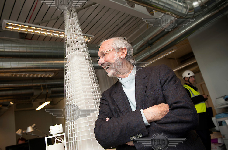 Architect Renzo Piano by a model in his new building, The Shard, at London Bridge. The Shard, which will be the tallest building in Western Europe is due to be completed and officially inaugurated on the 5th July 2012, opening to the public in 2013. It will contain offices, restaurants, a hotel, apartments and an observation deck.
