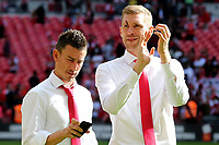Laurent Koscielny of Arsenal looks at his mobile phone and Per Mertesacker applauds the fans at the final whistle. Mertesacker was replaced in the first half after suffering a nasty cut to his face during Arsenal vs Chelsea, FA Community Shield Football at Wembley Stadium on 6th August 2017