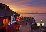 Seattle, WA<br /> Waterfront restaurant and pier at dusk, Elliott bay and the Olympic mountains in the distance