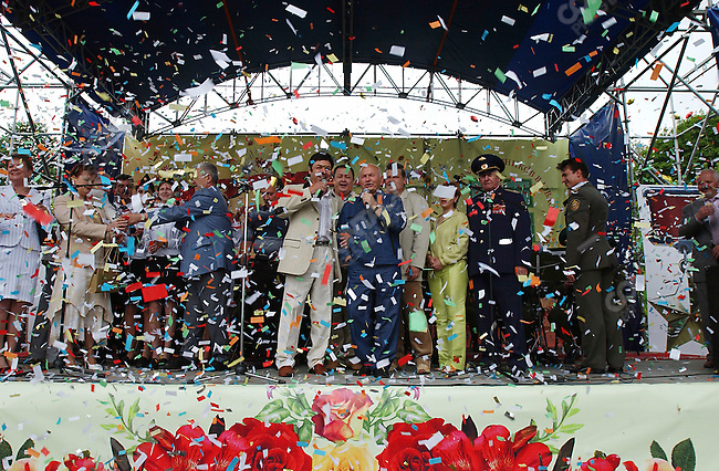 """Yuri Luzhkov, the Mayor of Moscow, opens a flower show at the Kuzminki Estate in south-west Moscow, aiding a local singer to belt out on stage the well known song """"Zolataya Maya Mosckva"""". Russia, June 18, 2005"""