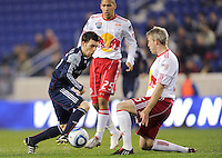 Nico Colaluca (26) of the New England Revolution look sto split Connor Chinn (25) and John Wolyniec (15) of the New York Red Bulls. The New York Red Bulls defeated the New England Revolution 3-0 during a U. S. Open Cup qualifier round match at Red Bull Arena in Harrison, NJ, on May 12, 2010.