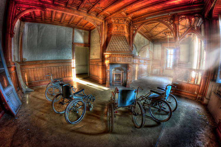 Wheelchairs in an old abandoned hospital