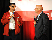 NWA Democrat-Gazette/ANDY SHUPE<br /> Dan Enos, offensive coordinator Dan Enos (left) speaks Friday, Aug. 18, 2017, with Chuck Barrett, voice of the Razorbacks, during the Kickoff Luncheon at the Northwest Arkansas Convention Center in Springdale. Visit nwadg.com/photos to see more photographs from the luncheon.