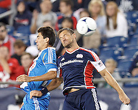 Philadelphia Union midfielder Michael Farfan (21) and New England Revolution defender Flo Lechner (2) battle for head ball. In a Major League Soccer (MLS) match, the New England Revolution tied Philadelphia Union, 0-0, at Gillette Stadium on September 1, 2012.