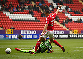 24th March 2018, The Valley, London, England;  English Football League One, Charlton Athletic versus Plymouth Argyle; Michal Zyro of Charlton Athletic accidentally stamps on Gary Sawyer of Plymouth Argyle while attempting to go for the ball
