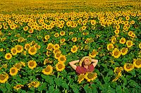 Woman standing in field of sunflowers, near Kathryn, North Dakota, AGPix_0078.