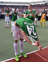 Fussball 1. Bundesliga   Saison  2012/2013   34. Spieltag   1. FC Nuernberg - SV Werder Bremen       18.05.2013 Nils Petersen (SV Werder Bremen) zieht nach Spielende sein Trikot aus