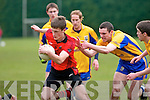 Glenbeigh/Glencar midfielder Colin McGillicuddy escapes the clutches of the Beaufort pack
