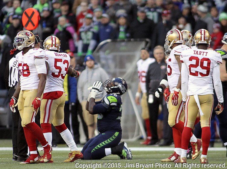 Seattle Seahawks guard Alvin Bailey (78) prays after wide receiver Doug Baldwin was injured against  the San Francisco 49ers at CenturyLink Field in Seattle, Washington on November 22, 2015.  The Seahawks beat the 49ers 29-13.   ©2015. Jim Bryant Photo. All RIghts Reserved.