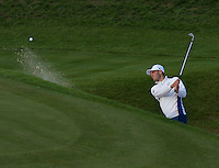 27.09.2014. Gleneagles, Auchterarder, Perthshire, Scotland.  The Ryder Cup.  Martin Kaymer (EUR) chips out of the bunker on the 18th during Saturday Foursomes.