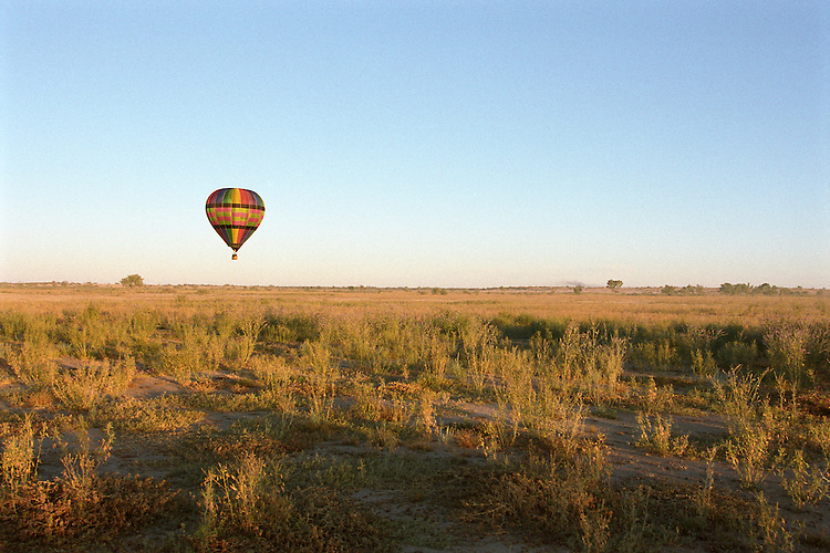 Hot air balloon takes flight in outback Queensland, Australia.
