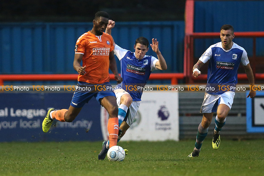John Rooney of Barrow with a late challenge on Ejiro Okosieme of Braintree during Braintree Town vs Barrow, Vanarama National League Football at the IronmongeryDirect Stadium on 1st December 2018