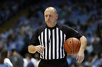 CHAPEL HILL, NC - MARCH 03: Official Tim Clougherty holds the ball during a game between Wake Forest and North Carolina at Dean E. Smith Center on March 03, 2020 in Chapel Hill, North Carolina.