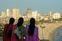 Indian women take in the view from Mumbai Garden overlooking the beach, Mumbai, India