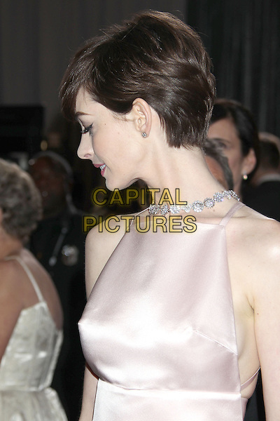 Anne Hathaway.85th Annual Academy Awards held at the Dolby Theatre at Hollywood & Highland Center, Hollywood, California, USA..February 24th, 2013.oscars half length pink sleeveless silk satin profile jewel encrusted embellished dress profile .CAP/ADM/RE.©Russ Elliot/AdMedia/Capital Pictures.