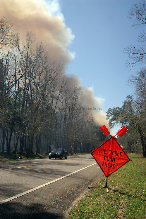 Warning signs are used to notify motorists that they are approaching an area that is being burned.
