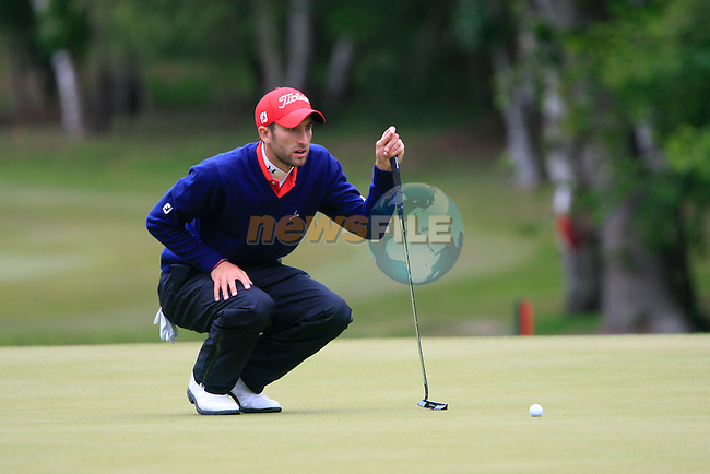 Seve Benson (ENG) lines up his putt on the 8th green during Day 3 of the BMW PGA Championship Championship at, Wentworth Club, Surrey, England, 28th May 2011. (Photo Eoin Clarke/Golffile 2011)