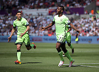 Kelechi Iheanacho of Manchester City (R) celebrates his opening goal as Swansea players protest to the linesman for an offside during the Swansea City FC v Manchester City Premier League game at the Liberty Stadium, Swansea, Wales, UK, Sunday 15 May 2016
