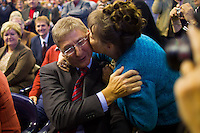 Supporter kisses Ferenc Gyurcsany (2nd R) former prime minister of Hungary before his speech during the Foundation of the Democratic Coallition Party in Budapest, Hungary on October 22, 2011. ATTILA VOLGYI