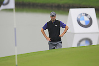 Ross Fisher (ENG) near the waters edge at the 3rd green during Thursday's Round 1 of the 2014 BMW Masters held at Lake Malaren, Shanghai, China 30th October 2014.<br /> Picture: Eoin Clarke www.golffile.ie