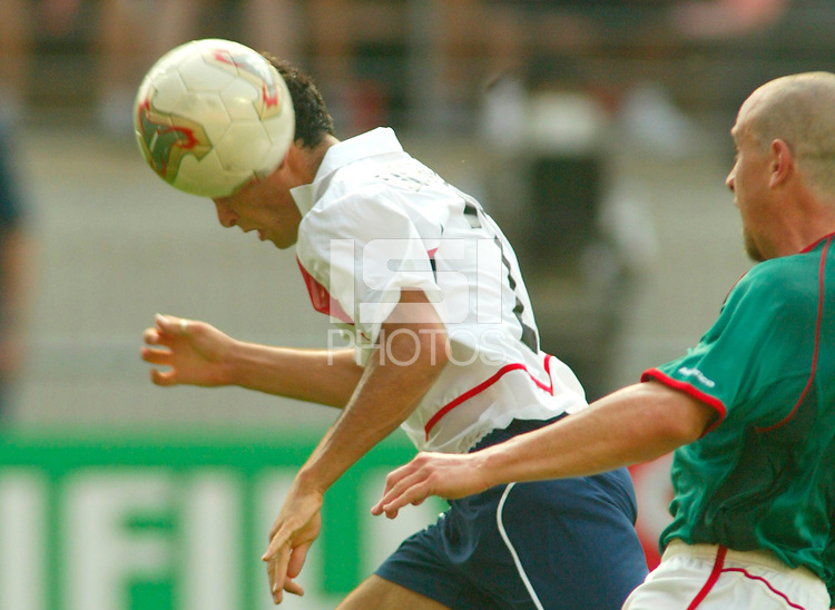 Landon Donovan heads in a goal. The USA defeated Mexico 2-0 in the Round of 16 of FIFA World Cup 2002 in South Korea on June 17, 2002.