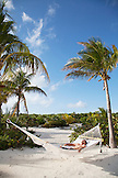 EXUMA, Bahamas. Grant relaxing on a hammock at the Fowl Cay Resort.
