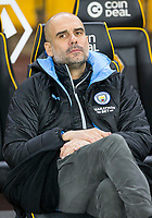 27th December 2019; Molineux Stadium, Wolverhampton, West Midlands, England; English Premier League, Wolverhampton Wanderers versus Manchester City; Manchester City Manager Pep Guardiola in the team dug out before the match - Strictly Editorial Use Only. No use with unauthorized audio, video, data, fixture lists, club/league logos or 'live' services. Online in-match use limited to 120 images, no video emulation. No use in betting, games or single club/league/player publications