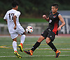 Sebastian Matos #12 of Half Hollow Hills East, right, puts pressure on Fernando Hernandez #17 of Whitman during the second half of a Suffolk County League II varsity boys soccer game at Whitman High School on Monday, Sept. 19, 2016. Matos scored a goal  in the eighteenth minute of play to extend Hills East's lead to 2-0. They went on to win by a score of 2-1.