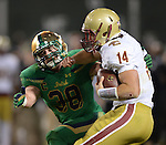 (Boston, MA, 11/21/15) Notre Dame's Joe Schmidt, left, attempt to sack Boston College quarterback John Fadule during the second quarter as Notre Dame hosts Boston College at Fenway Park in Boston on Saturday, November 21, 2015. Photo by Christopher Evans
