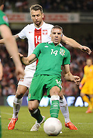 29th March 2015; UEFA EURO 2016 Championship Qualifier Group D, Ireland vs Poland, Aviva Stadium, Dublin<br /> Republic of Ireland's Jon Walters with Jakub Wawrzyniak of Poland.<br /> Picture credit: Tommy Grealy/actionshots.ie.