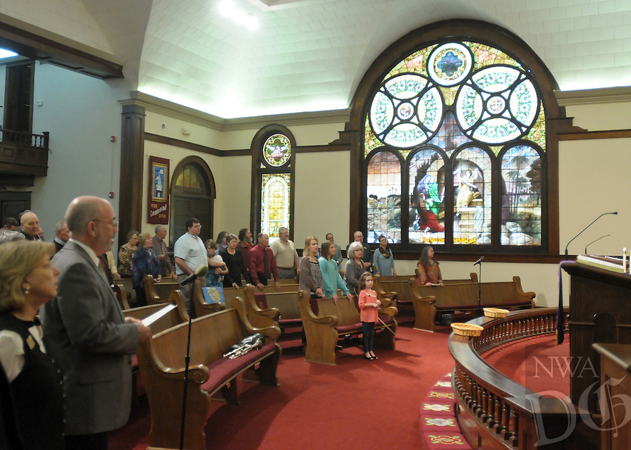 NWA Democrat-Gazette/BEN GOFF @NWABENGOFF<br /> The congregation joins in prayer on Sunday March 13, 2016 during the Laughter Sunday service at First United Methodist Church in Rogers.