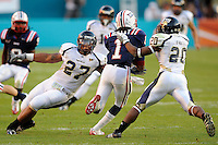 29 November 2008:  FIU fullback John Ellis (27) and defensive back O'Darris D'Haiti (20) attempt to tackle Florida Atlantic wide receiver Avery Holley (1) during a kick return in the FAU 57-50 overtime victory over FIU in the annual Shula Bowl at Dolphin Stadium in Miami, Florida.