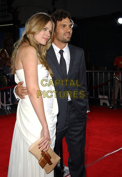 "MARK RUFFALO & SUNRISE RUFFALO.Dreamworks Pictures' Los Angeles Premiere of ""Just Like Heaven"" held at The Grauman's Chinese Theatre in Hollywood, California  .September 8th, 2005.half length married husband wife white dress brown clutch purse blue pinstripe suit arm around waist.www.capitalpictures.com.sales@capitalpictures.com.Supplied By Capital PIctures"